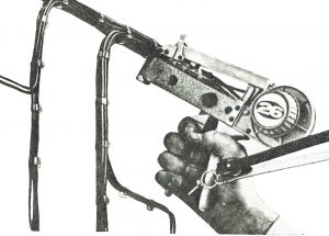 1965 photograph of the Tyton continuous strap bundling system